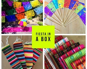 Mexican fiesta party pack, 1 papel picado banner, 1 table runner, 6 serape coasters and 1 set of centerpiece flags. Fiesta party supplies.