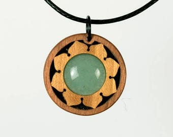 Aventurine jewelry and pendant. Jewellery from lemon tree wood and cherry wood. Crafts from the Bavarian Forest, Germany.