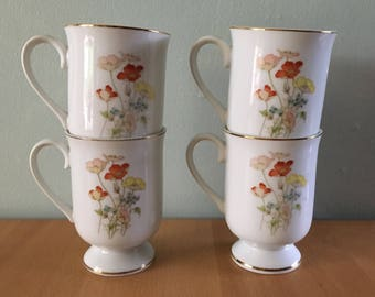 Four Fanei Florals Collection white ceramic Painted Poppy pedestal mugs orange yellow flowers with gold rims for tropical Old Florida home!