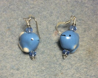Light blue ceramic fish bead earrings adorned with light blue Chinese crystal beads.