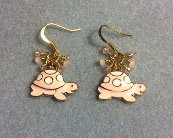 Light pink and white enamel turtle charm earrings adorned with tiny dangling light pink and peach Chinese crystal beads.