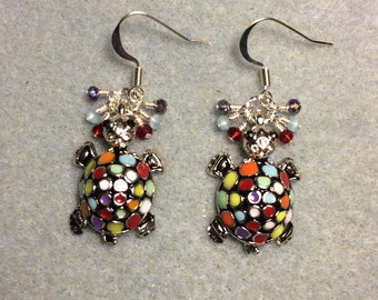 Colorful enamel mosaic turtle charm dangle earrings adorned with tiny dangling red, light blue, and violet Chinese crystal beads.