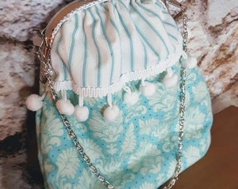 Turquoise make-up case with metal clasp and chain