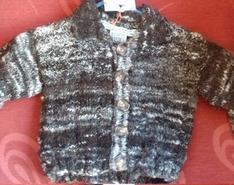 Hand knitted cardigan, knitted with home spun wool to fit a baby boy aged 3-6 months old