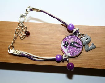 Bracelet black cat on purple background with leather and glass