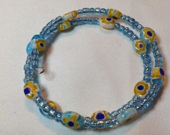 Memory wire adjustable bracelet with yellow Milfori flower glass beads and blue seed beads