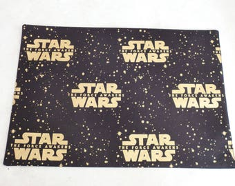 Placemat. Star Wars - The Force Awakens.  Gold on black.  Cotton Fabric.  Washable.