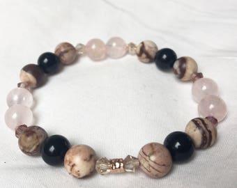 Jasper Rose Bound.Beaded bracelet.Australian Zepra Jasper and black Onyx, crystals and Karen hill ttuve rose gold bead.