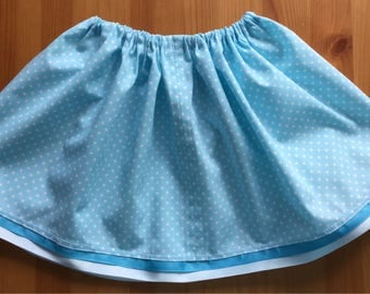 Sky blue and white dotted drawstring toddlers skirt.