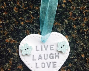 "Handmade Clay heart inscribed ""Live Laugh Love"" with 2 dotty buttons"