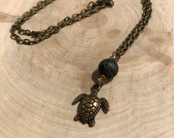 Essential oil diffuser necklace, lava rock and turtle bronze pendant