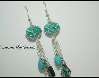 Earrings dangle with beads transparent and blue on chain