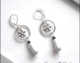 Nice pair of earrings with a Pearl drop suspended from a ring and a flower gray white