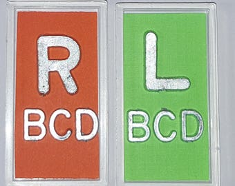 Orange and Green XRay Markers With Lead Initials