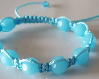 Shamballa style bracelet with light blue round faceted glass beads