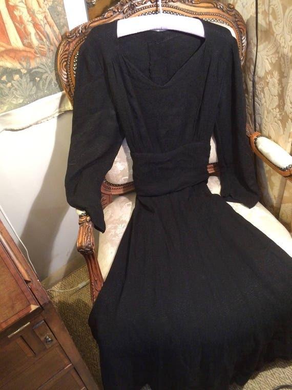 Genuine 40's embossrd crepe long dress. 38x28x53 ins length. Good. Lovely shape