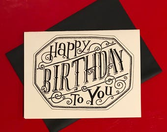 black and white hand lettered happy birthday to you card