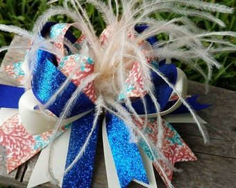 Overthetophairbow,ivory,royal blue,ivory feathers