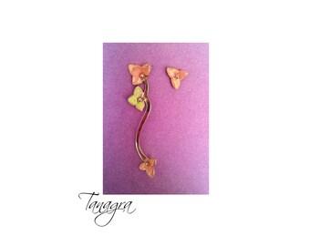 Asymmetrical earrings. Gold enamel.