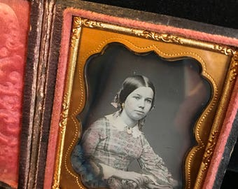 Antique 1/9 plate daguerreotype photograph of a beautiful young woman.