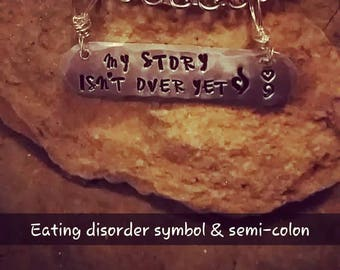 My story isn't over yet, with eating disorder symbol and heart semi-colon....hung on stainless steel chain
