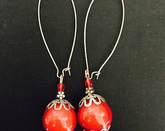 Long earrings with red bead