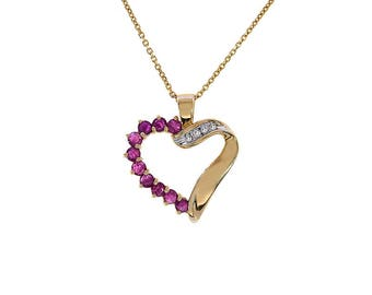 0.79 Carat Ruby And Diamond Accent 10K Yellow Gold Heart Pendant With 14K Yellow Gold Chain