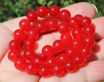 2 RUBY RED 8MM ROUND BEADS. AF37.