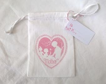 Small fabric bag celebrates mothers pink heart