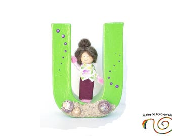Green U decoration to ask, letter name and paper mache figurine