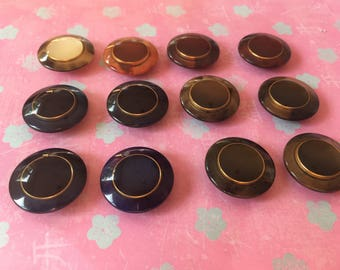 Twelve glossy round vintage buttons various colours blue green