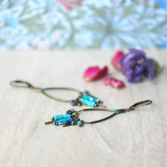 Teal pendant earrings, boho earrings with tassels and long beads, handmade patterned, on brass