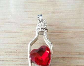 A piece, rhinestone silver plated charm