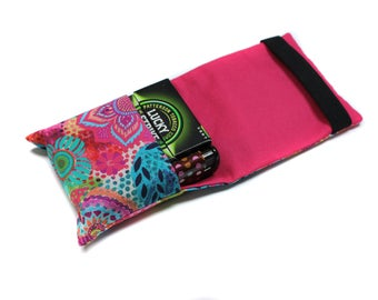 Pack of cigarettes in colorful fabric case