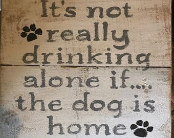 Drinking alone dog sign