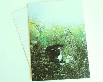 Greeting card with image of a cat in the garden