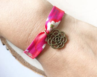 Adjustable bracelet with bias pink Liberty Mitsi hot pink and charm