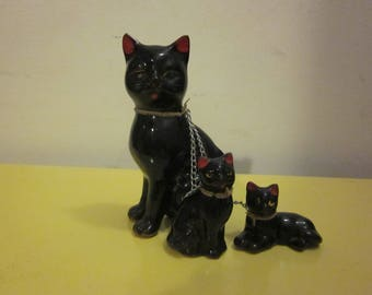 Vintage black cat with two kittens, with chain.