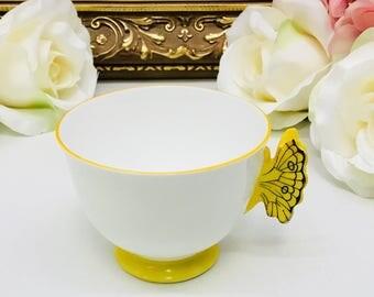 Aynsley butterfly handle orphan teacup circa 1934-1950.