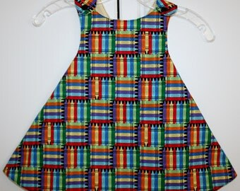 2T, Multi Color Crayon Reversible Sundress with Yellow Print.
