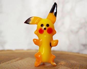 Glass pokemon figures, a pokemon toy figurines, decorations, pokemon party supplies, pokemon room decor, pokemon toys, yellow pokemon