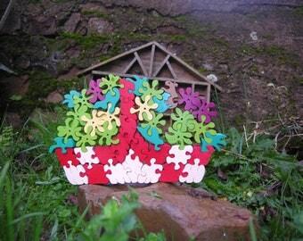 Puzzle multicolor, one of a solid wooden basket unique