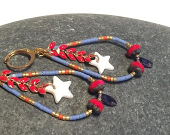 Earrings drop decorated with a star with mother of Pearl, enamel chain
