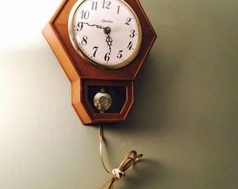 Vintage Spartus Pendulum Swinging Wall Clock