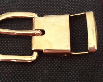 Golden metal belt buckle, which is clipped width from 2 cm