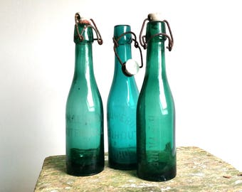 Old bluish green glass bottle engraved
