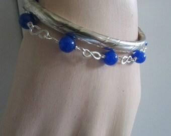 Sterling Silver Infinity  Bracelet Set.