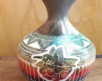 Navajo etched and horse hair pottery.