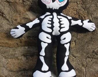 Santa Muerte skeleton doll