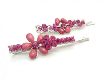 set of two hair clips all in pink rhinestones